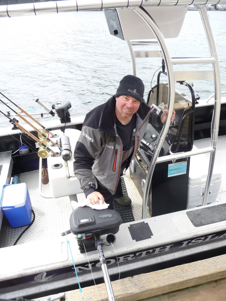 * DJ enjoying being back out on the water and especially pleased with the off season addition of the T-top to his boat.