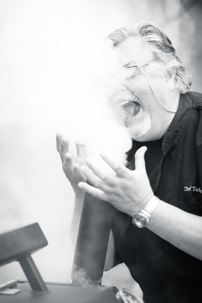 * Chef Ted Reader enjoying the smokey aroma pouring out of the Yoder Smoker!
