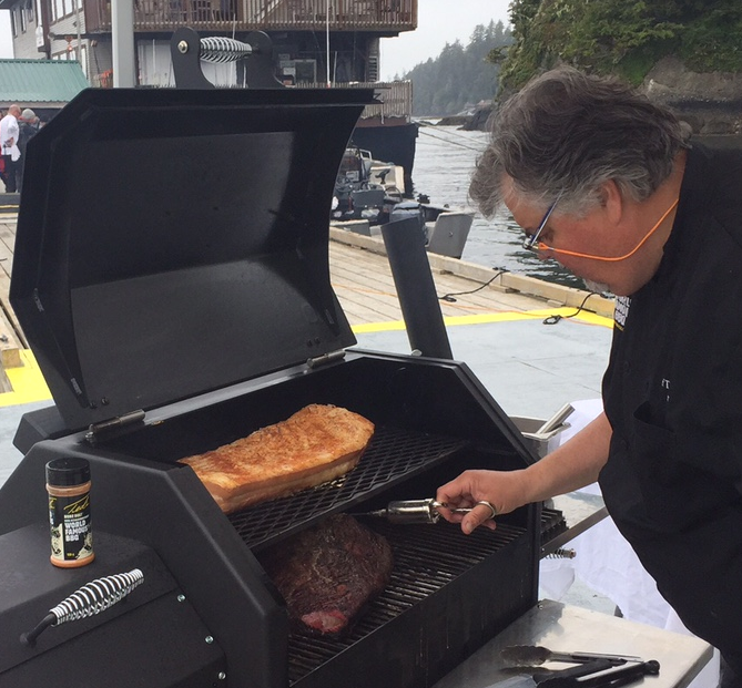 * Chef Ted Reader injecting some additional flavor into the brisket.
