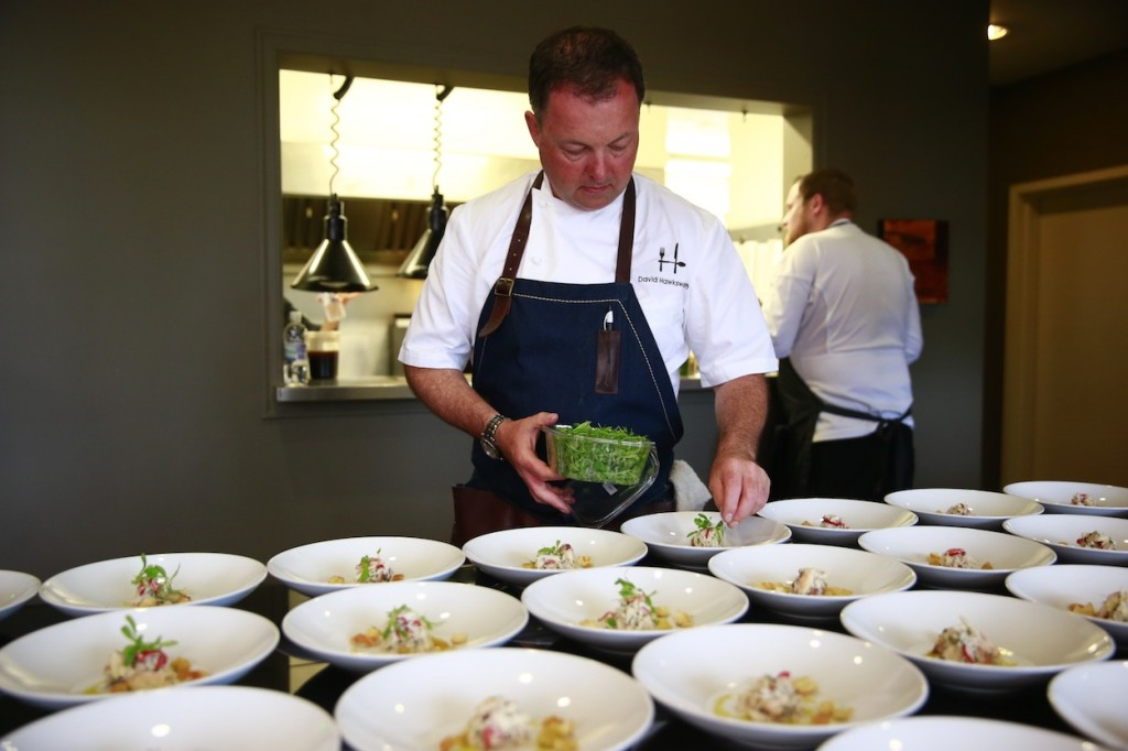 * David Hawksworth putting the finishing touches on one of his beautifully crafted dishes.