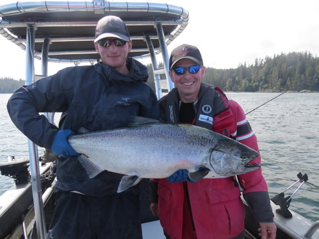 * Mike Oakely and Guide Brent Gallacher with a 33.5lb Tyee.