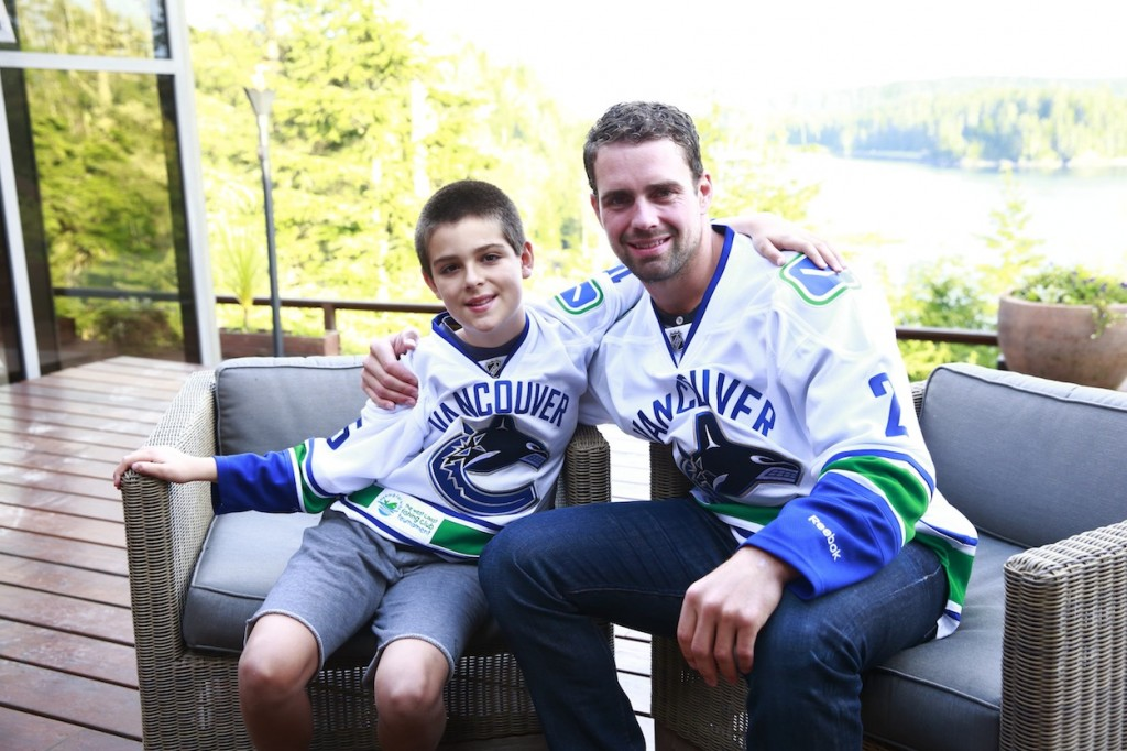 * Ledcor Champion Child Owen Hilderley and Dan Hamhuis enjoying time together on The Clubhouse deck.
