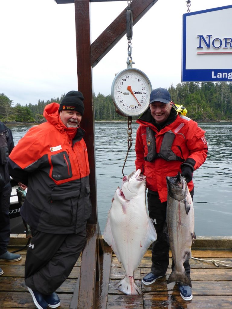 <em>* Ted Reader and Andy Annat with a 40lb Hali and 21 opening day Chinook. </em