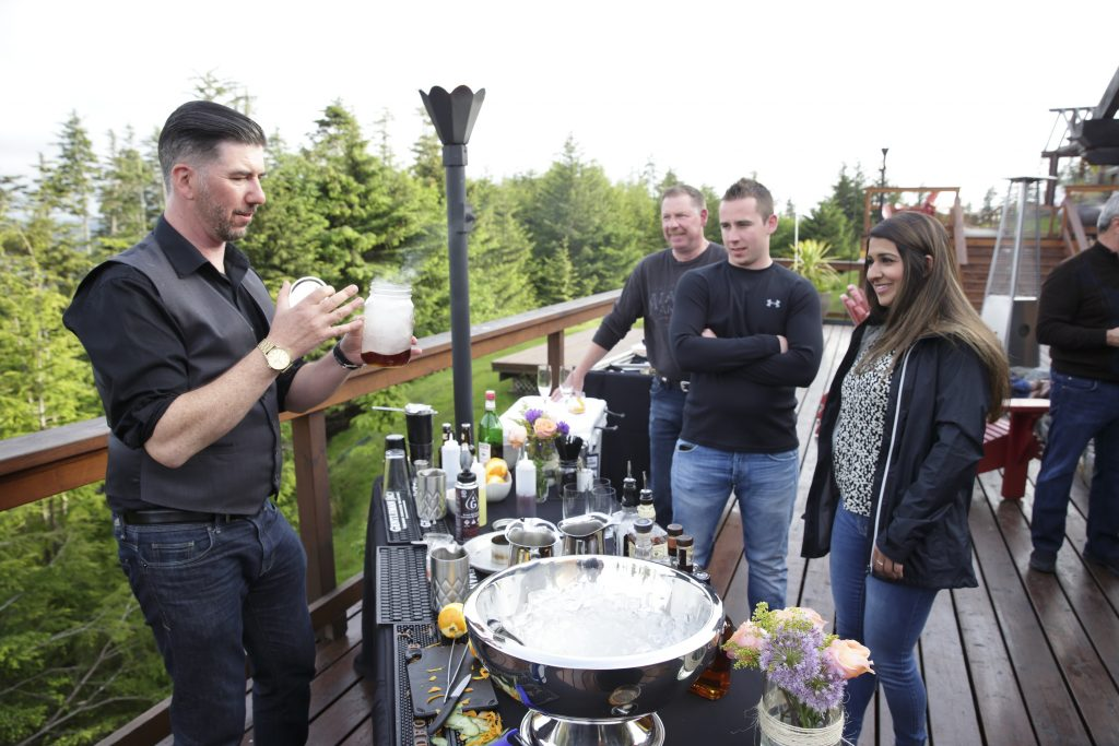 Guests watch closely as Gerry prepares another Smoked Apple Wood #7 Old Fashion