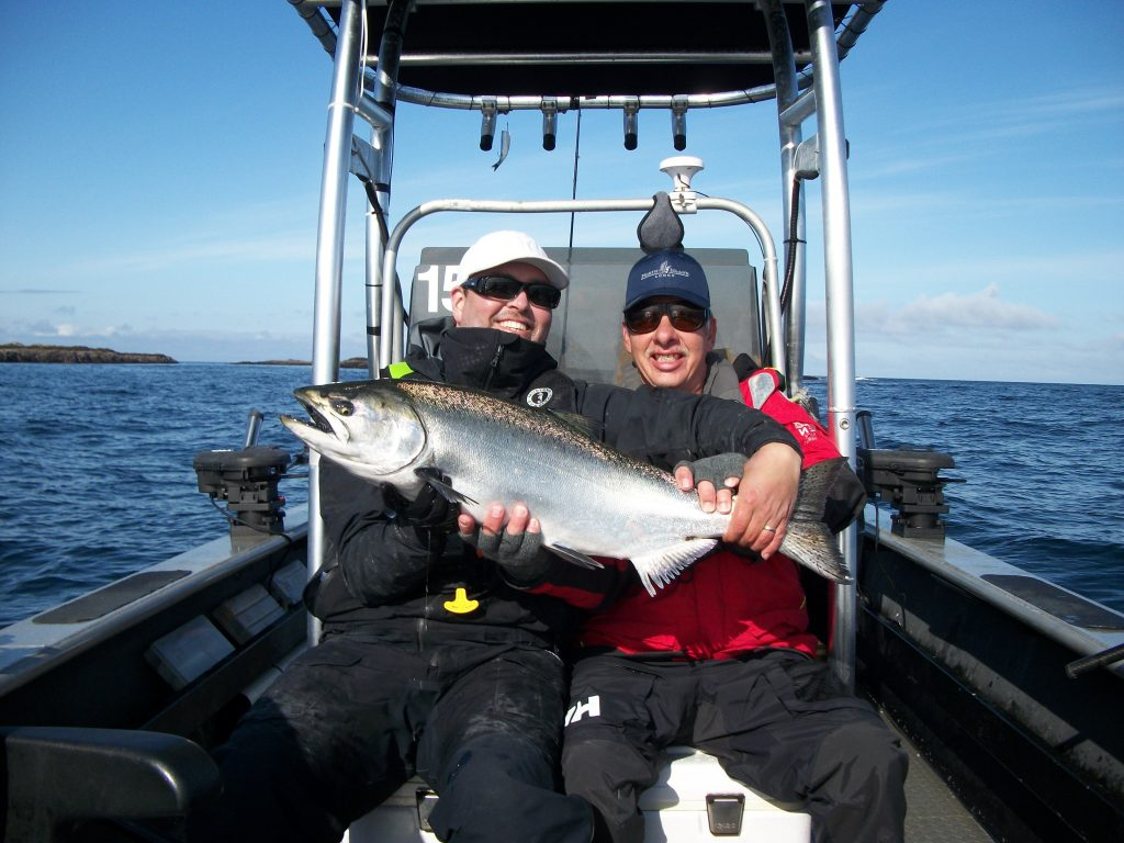 "<em>""John Godlasky with guide Jason and a 25lb Chinook. </em>"