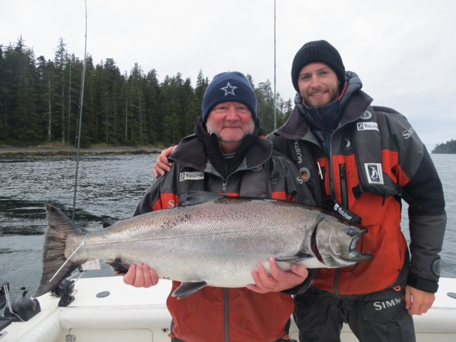 <em>* Norm Pitcher and son Ian with a 32lb Tyee. </em>