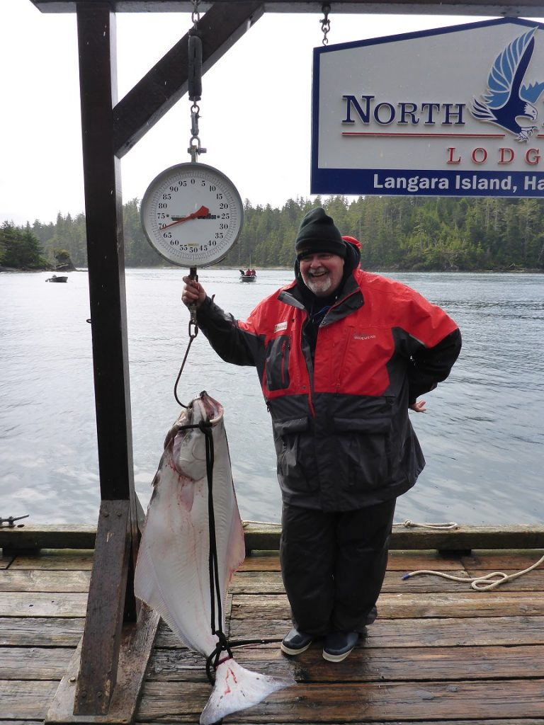 <em>* Ted Reader with his 60lb Hali caught off Cohoe point on Salmon gear. </em>