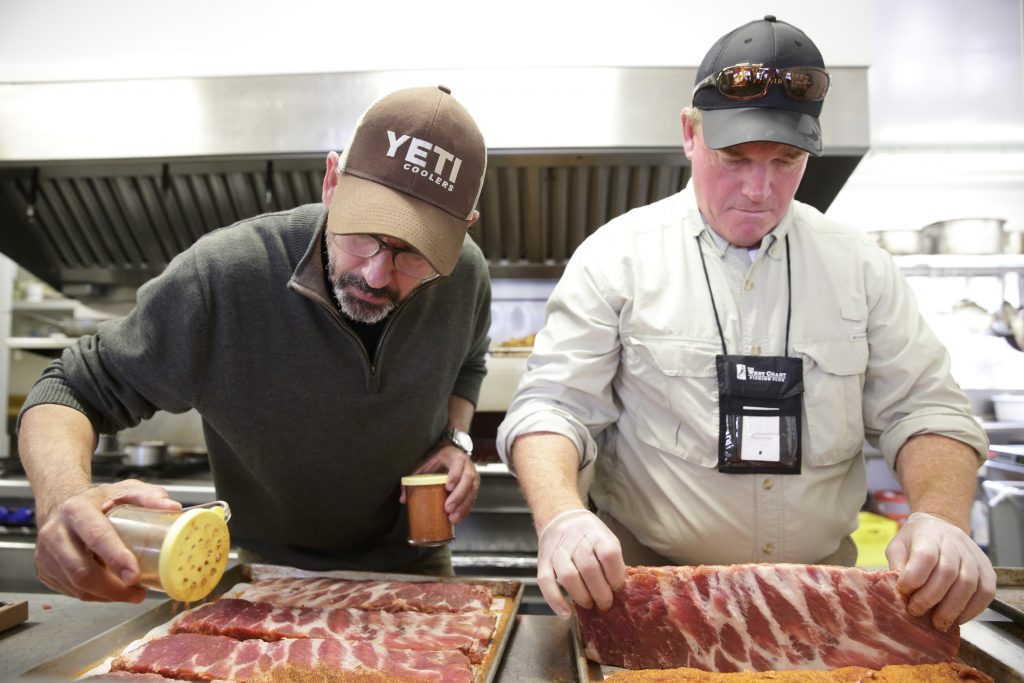 Tuffy Stone Jr. & Jeff Hayes prepping the ribs for Stations Night at The Clubhouse