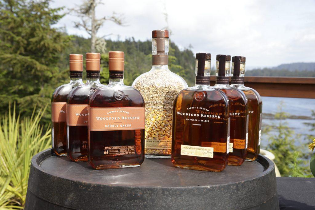 Woodford Reserve display a top the custom Jack Daniels Barrel