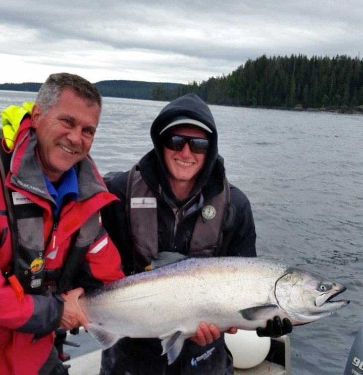 <em> * Brett Mott with guide Clayton and a 34lb Tyee. </em>