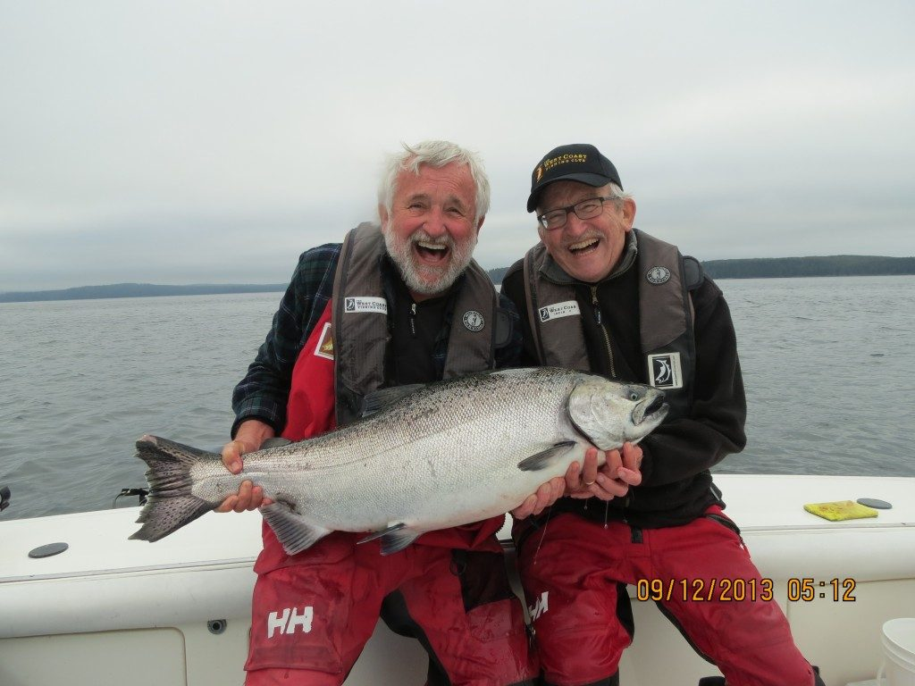 <em>* Jim and Jack Burbidge all smiles with a 30lb September Tyee. </em>