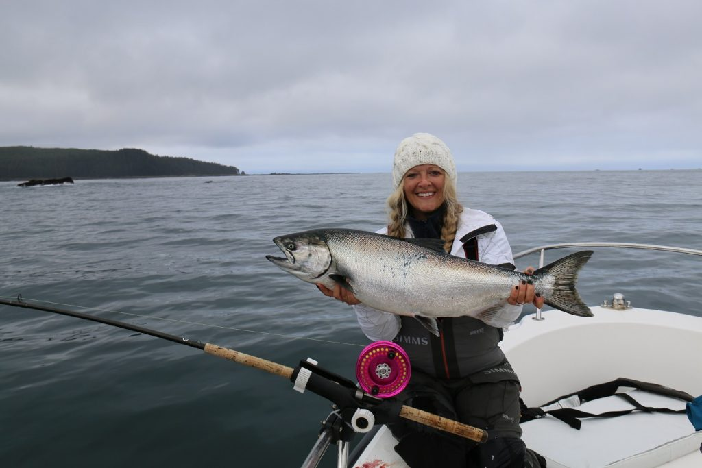 <em>* Kristie Nyrose with her pink Islander Reel and a nice Chinook. </em>
