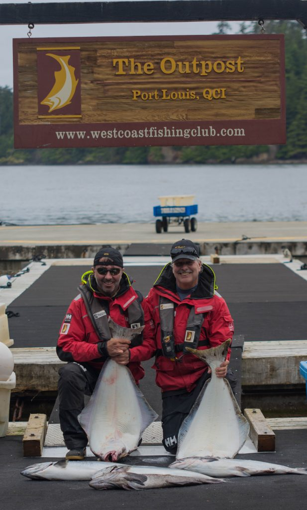 <em>* Steve Patittuci and Ernesto Licursi celebrate a good day on the water. </em>