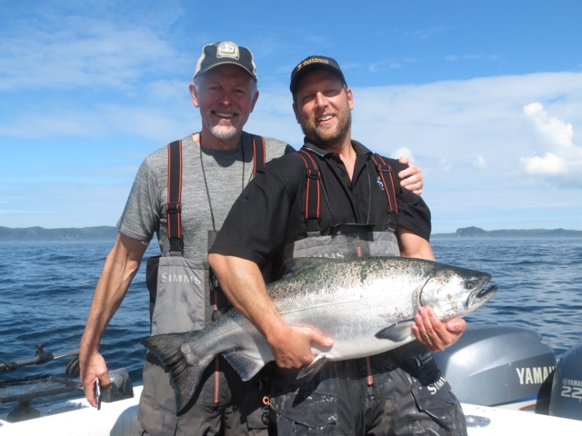 <em>* Father and son anglers pose with a nice Tyee. </em>