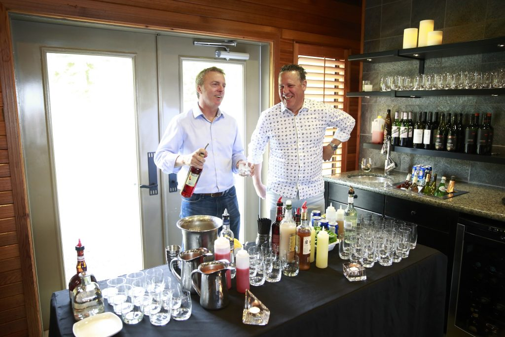 <em>* Mark Davidson and Dino Renaerts enjoying themselves behind the bar. </em>
