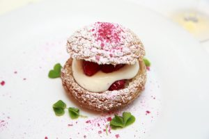 * Cream puff, its crisp pastry full to bursting with white chocolate mousse and sweet fresh raspberries.