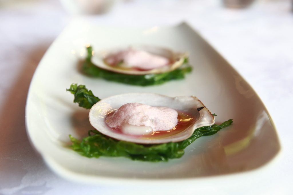 <em>* Raw Princess scallops form the Magdalen islands, served on the shell in their refreshing rhubarb water marinade, topped with tarragon-spiked strawberry foam. </em>