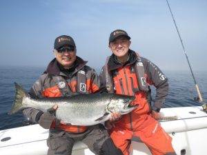 * A couple very happy guests with a prized Chinook high slack Westbank.