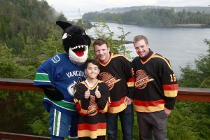 * Fin, Champion Child Brandon Carinha, Derek Dorsett, and Sven Baertschi on the back deck of The Clubhouse.