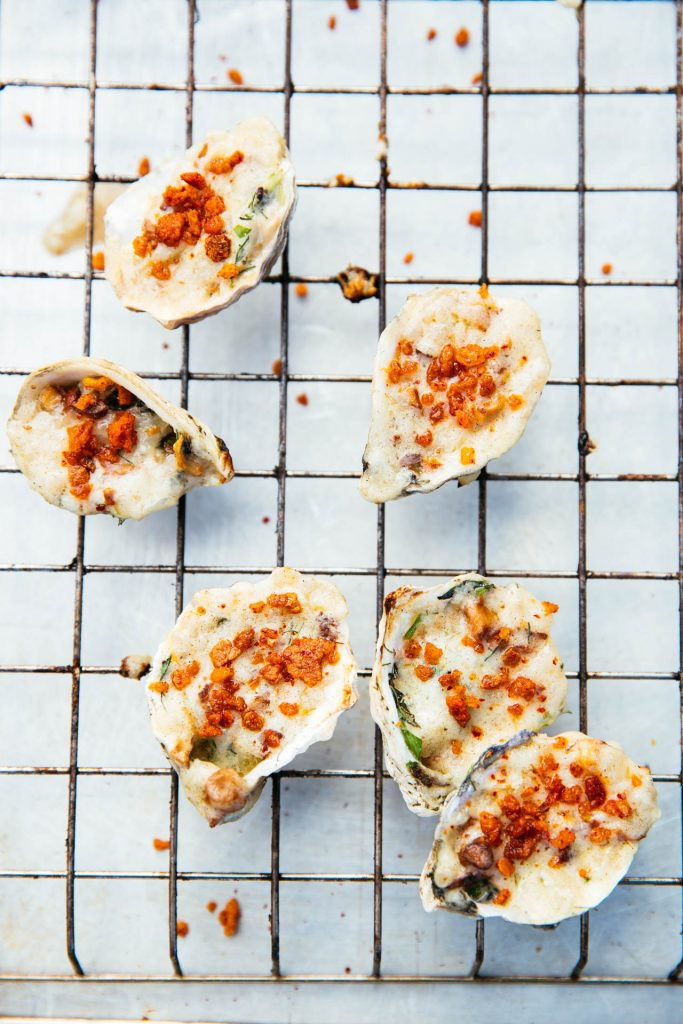 <em>* Chef's Charle's take on baked oysters - a guest favorite! </e,>