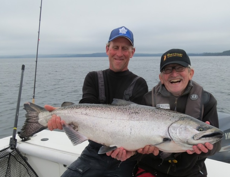 * Screamer and Jack Burbidge proudly showing off a September Tyee. Date Sept 13, 2013.