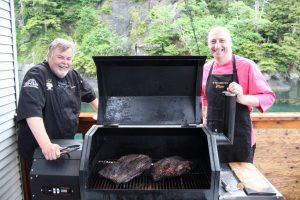 * Ted Reader & Andy Annat gather around the finished 12 hour brisket on the Yoder Smoker.